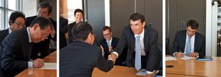 Toshishige Hamano & Arno Harris sign merger agreement between Sharp & Recurrent Energy